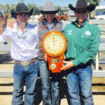 Corey & Trudy Holden & Hugh Miles showing off the trophy clock at Come by Chance