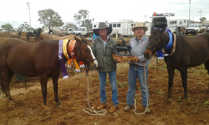 Ron Wall & Debonaire & Owner Rick Young and Glamour with the winnings from Cloncurry.