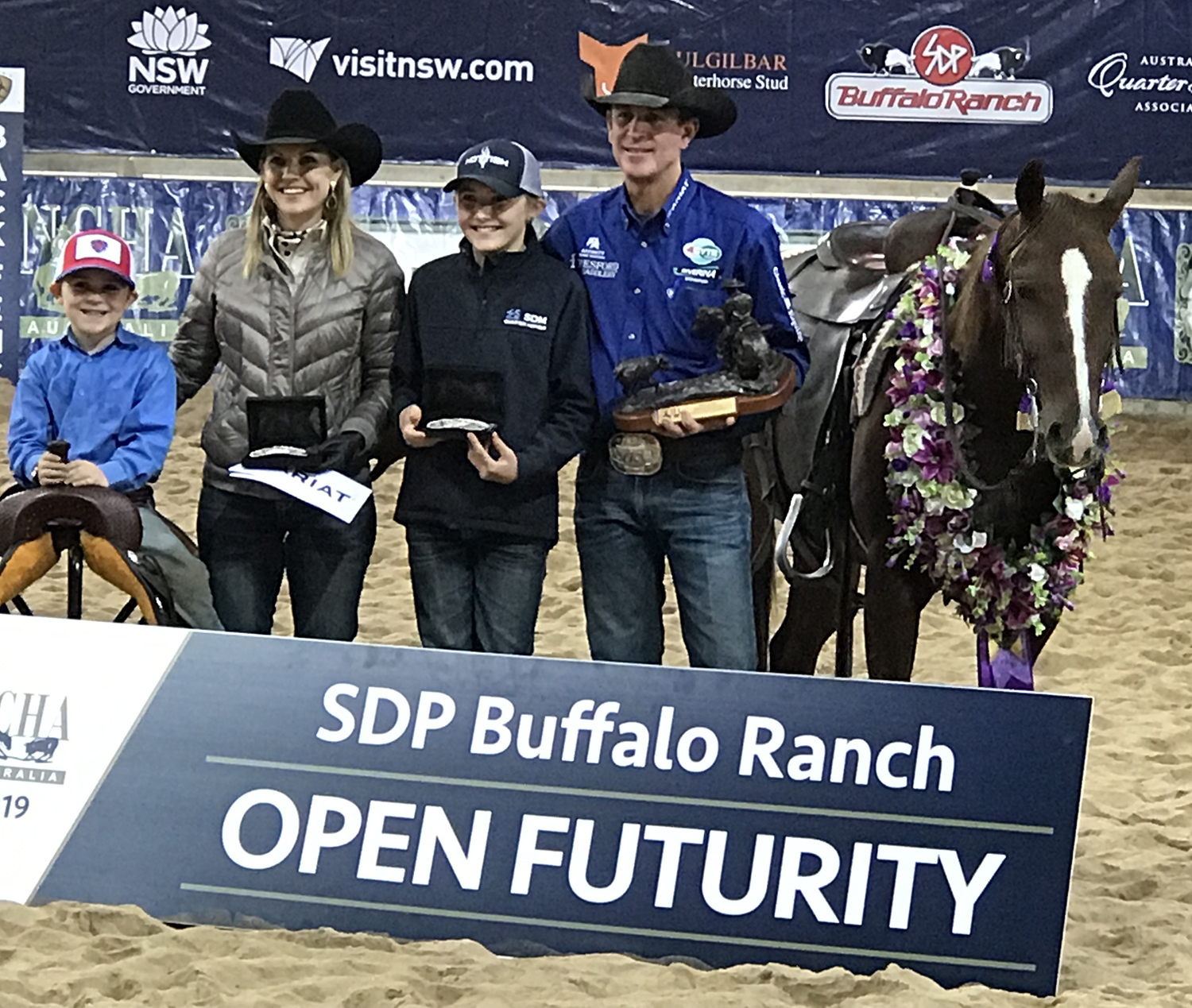 Todd Graham & his family with Hellis, 2019 NCHA Open Futurity Champion.