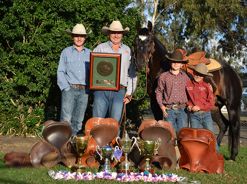 Marnies Destiny with Rick Young and his boys proudly showing off his AQHA Inductee Award.