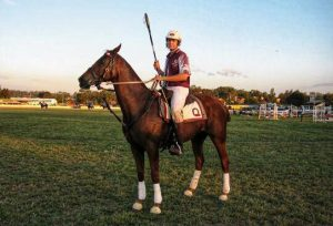 Jamie Seccombe playing polocrosse